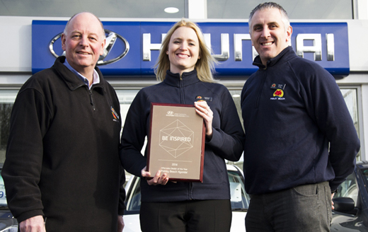 520 Aftersales team members Steve Lawro Kathryn Harris and Martin Trelby with their award