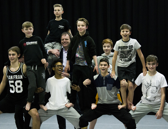 Pebley Beach MD Dominic Threlfall supports a human pyramid with boys from Stereotype dance class